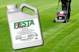 Fiesta weed control product shown on green lawn being mowed by push mower